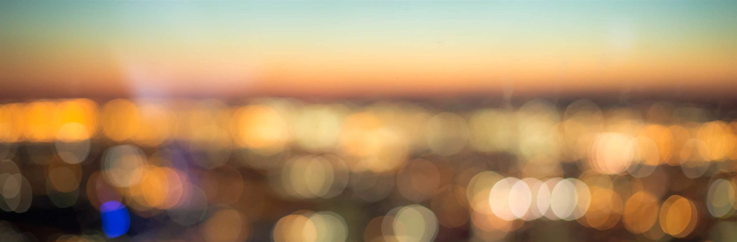 abstract blurred aerial view of sunset over city